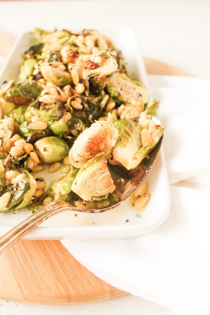Roasted Brussels Sprouts Salad served with serving spoon